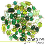 Gold Wire Wrapped Green Toned Glass Beads